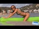Micro bikini model wet photoshoot on an airbed