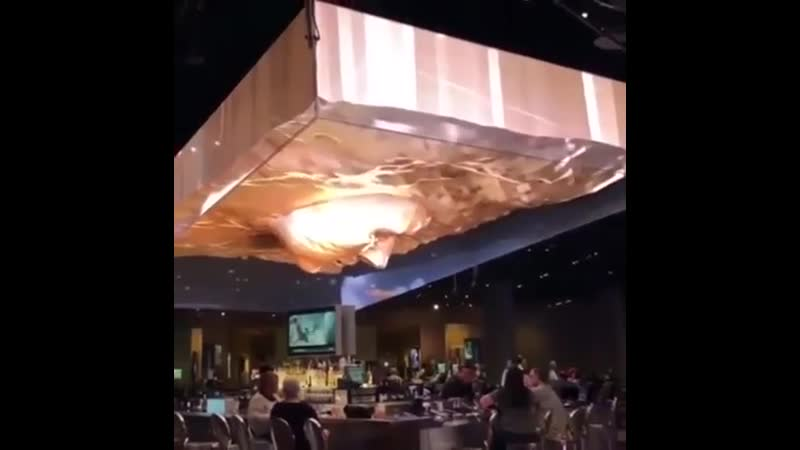 3D display on top of the ceiling of a restaurant.