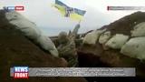 Позиции ВСУ на Мариупольском направлении. Военный размахивает флагом со свастикой под немецкие марши