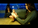Girl doing foot massage to another girl while talking