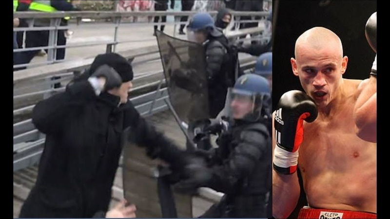 Former champion boxer, Christophe Dettinger, punches police during Paris yellow vest protest