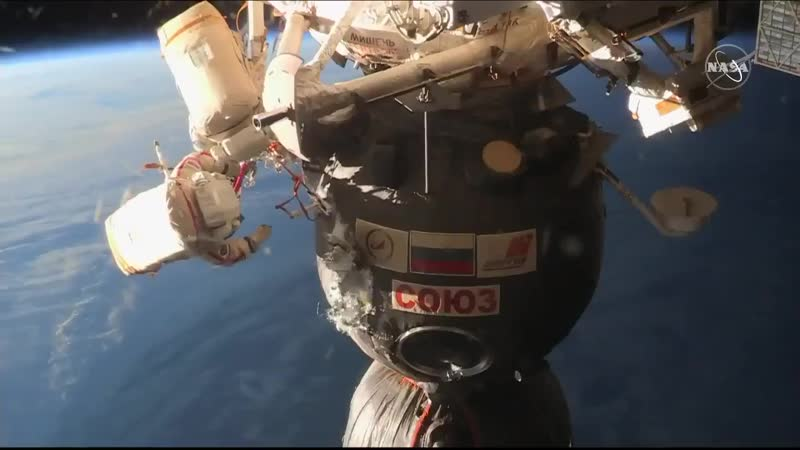 Two spacewalkers work 263 miles above Earth performing a high-flying vehicle inspection on
