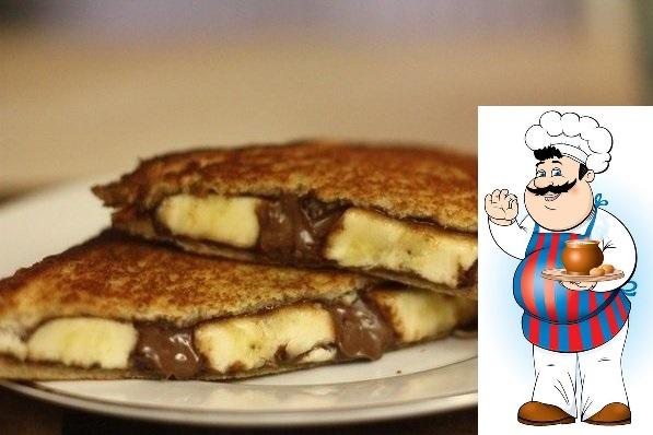 Блаженство за несколько минут Готовить очень просто, не очень дорого,а как вкусно! Ингредиенты: пару кусочков тостерного белого хлеба, 1 ст.л. шоколадной пасты, 1 банан. Приготовление: Кусок