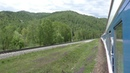 Горы и природа Байкала. Вид из окна вагона. Поездка на поезде