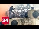 Отобрали камеру в Афинах избит толпой стрингер Спутника Россия 24