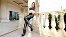 Black leather leggings high heeled shoes long legs