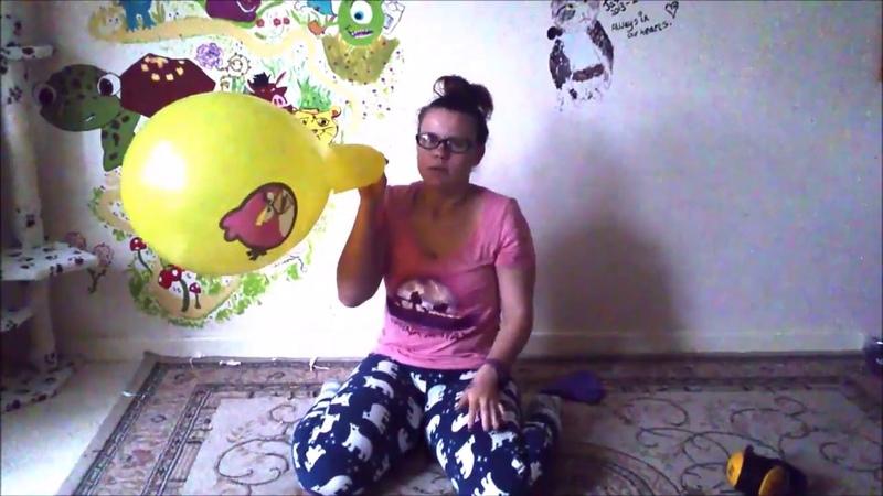 Pyjama girl blows to pop angry birds balloon