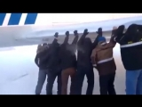 Passengers push jet plane!