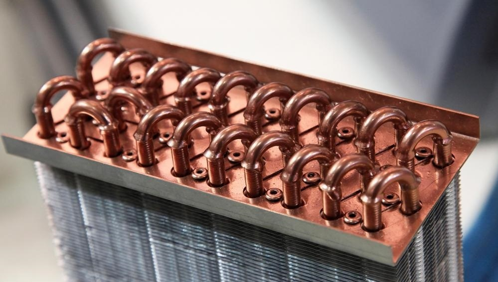 Некоторые теплообменники используют трубчатые перегородки для излучения тепла.