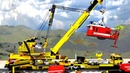 Big Lego railway crane lifting locomotive after a heavy storm