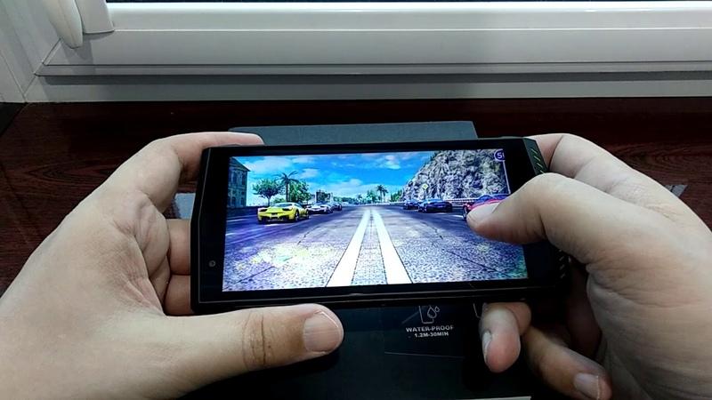 Распаковка и обзор защищенного телефона POPTEL P60