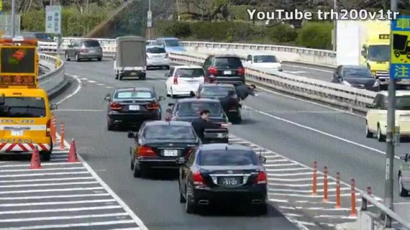 Japanese Prime Ministers convoy merging onto highway