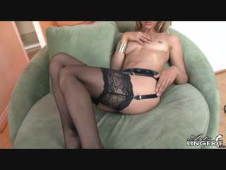 Crystal klein topless in black crotchless garter and panties.
