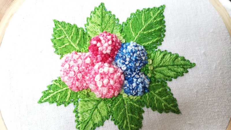 Hand embroidery of hydrangea flowers and leaves