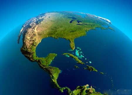 Глобус, показывающий Карибское море, одно из мест, где практикуется вуду