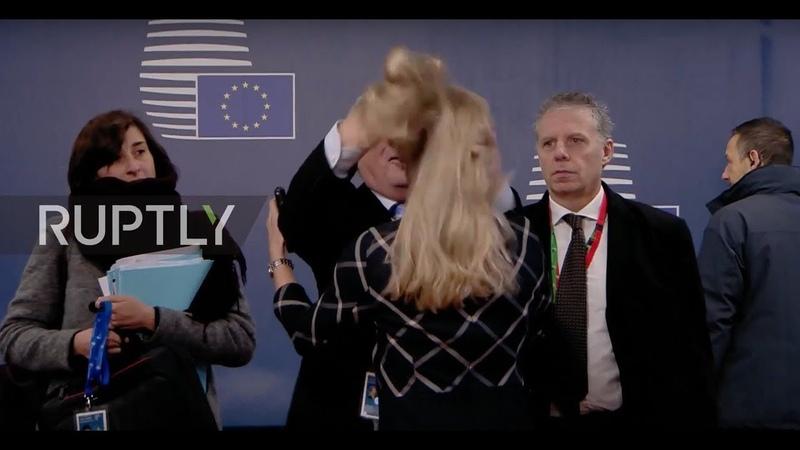 Belgium: Juncker flips woman's hair as leaders arrive for EC summit in Brussels