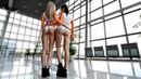 Walking in International motor show. Girl Auto, in Lycra, Spandex Body