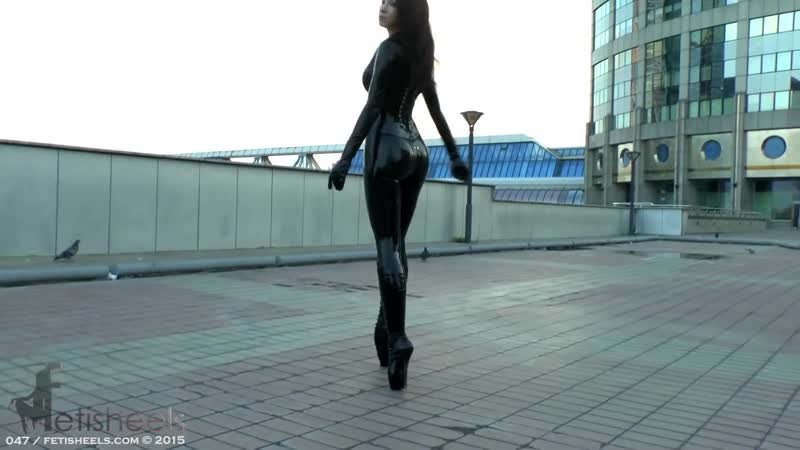 Beautiful Sexy Girl Wears Extreme High Heels and latex