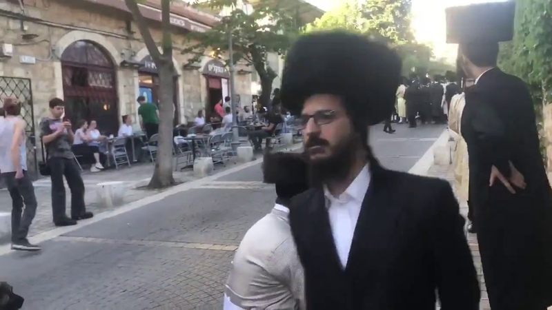Women in bras vs ultra orthodox Jewish protesters against Eurovision being held