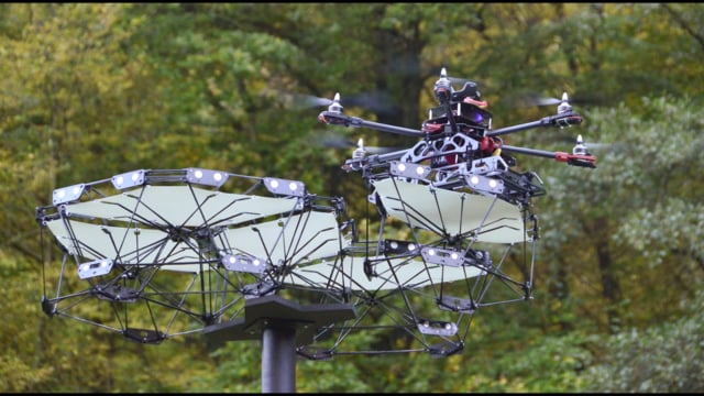 Cyber Physical Macro Material as a UAV [re]Configurable Architectural System