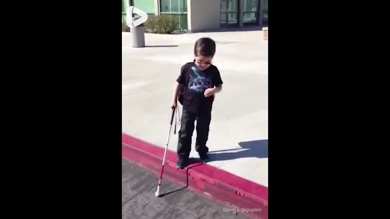 Blind 4 year old boy steps off curb for the first time