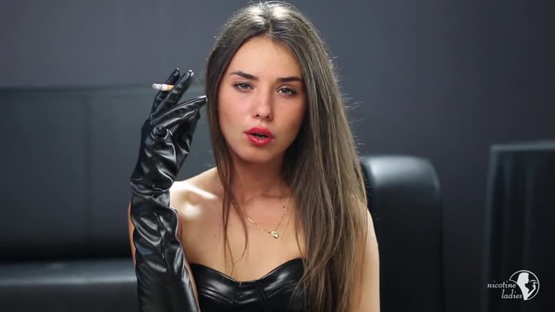 Beautiful girl in gloves smoking a cigs