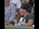 Boston Red Sox fan gives a foul ball to a young Yankees fan