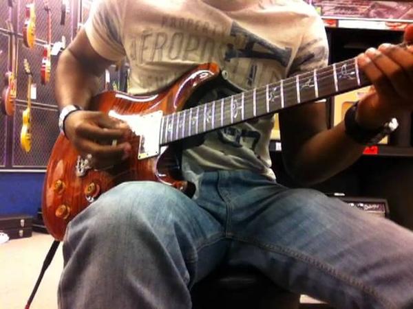 Chris Payton shedding in Guitar Center