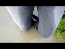 Girl in wet jeans and rubber boots with high heels in deep muddy water (1) MOV 0011 26072018