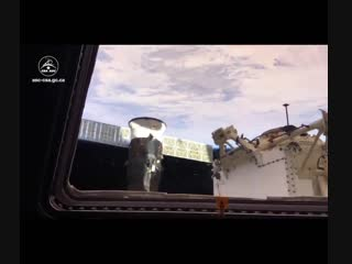 View of SpaceX Dragon 1 berthed with @Space_Station in the last Cupola opening