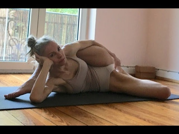 Ashtanga Yoga Infinity Pose leg behind head hip opener