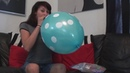 Girl blows up another dotted link balloon so big it popped