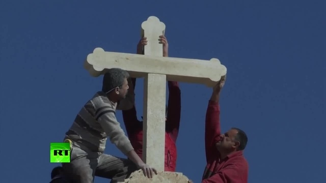 Crucifix restored atop Christian church in Iraq after area retaken from ISIS