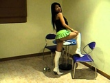 Sexy Khmer Natyaba teasing in white plastic boots and micro skirt