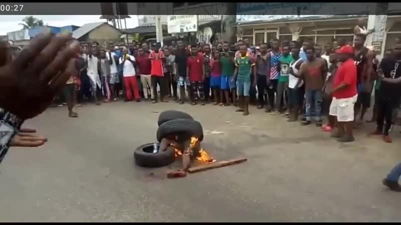 Сжигание за воровство Африка 8