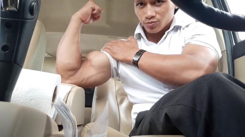 Flexing biceps in car