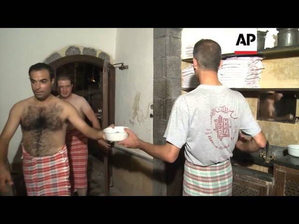 Men enjoy bathing at ancient Damascus hammam 2014