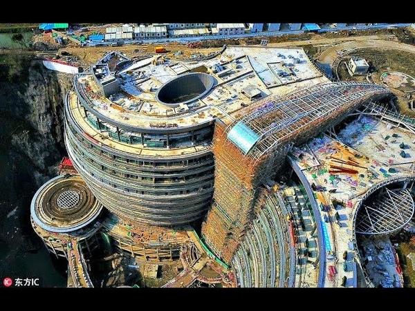 Китай не прекращает шокировать! Подземный отель в карьере