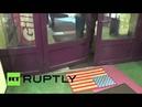 Russia: Shoppers wipe their feet on USA door mat