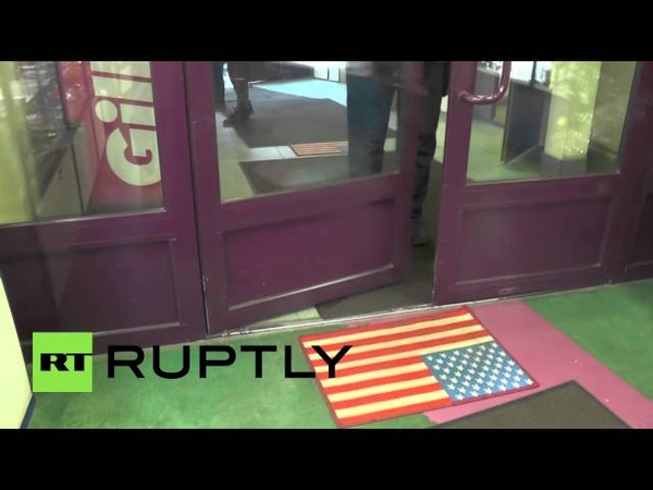Russia Shoppers wipe their feet on USA door mat