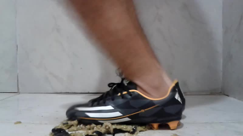 Crushing eggplant with adidas football boots