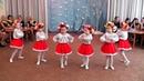 Український таночок з віночками та стрічками в дитячому садку
