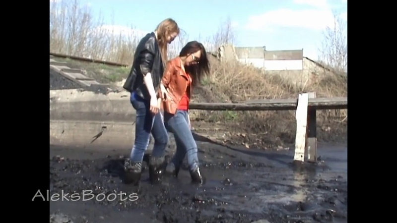 Girls Tanya and Lena playing in rubber boots in spring mud. Part-2(260415)