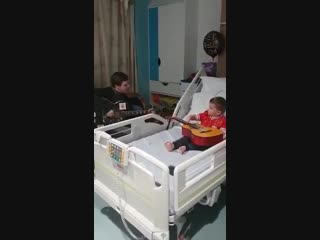 Jamie webster visiting a young lad is hospital