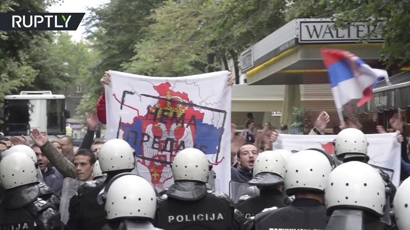 Far right protesters clash with police over Kosovo Albanian festival in Belgrade