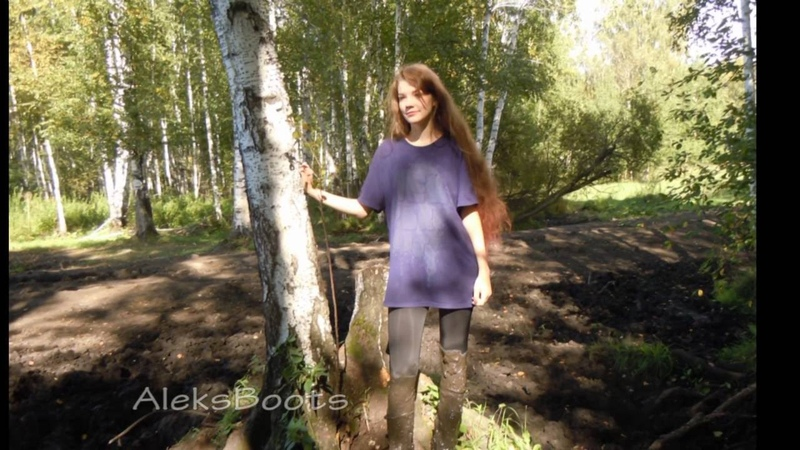The girl Nastya plays with her rubber boots in the 09 16