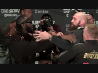 FACE-OFF! Deontay Wilder and Tyson Fury push each other and thrown off stage