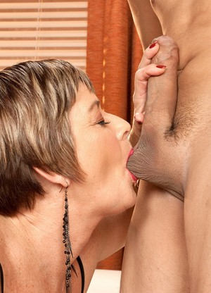 Older blond and youthful dark brown lesbian