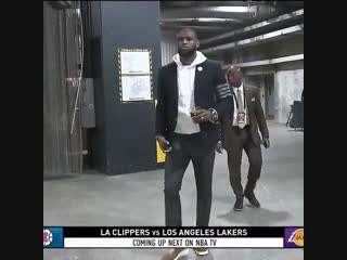 Bron walked into staples center with a glass of red wine in his hand.
