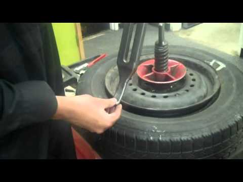 Removing tire using old school tire machine by Karn M